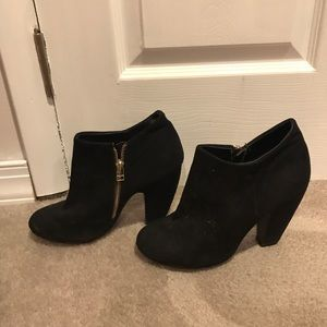 Black suede heels with gold side zipper